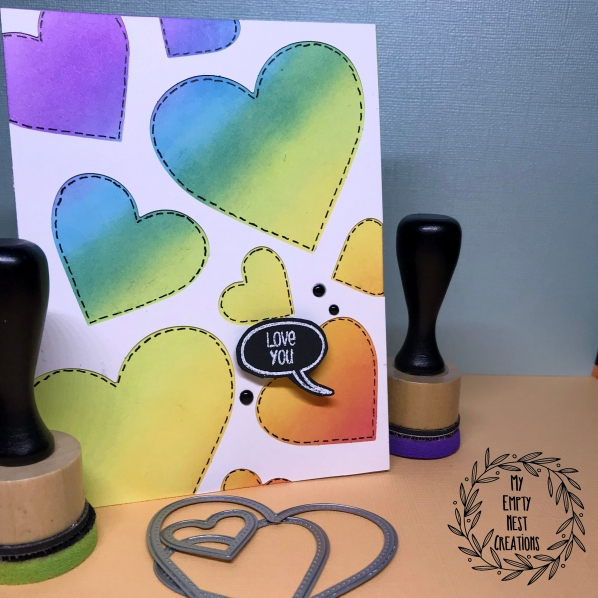 Rainbow Hearts Love You Card using MFT Pierced Heart dies and Distress Oxides